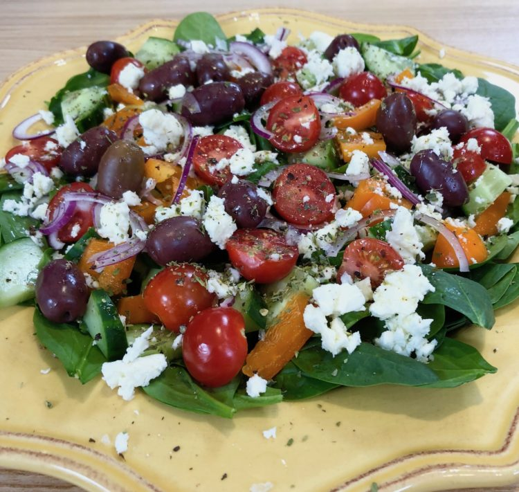 Greek Salad on a Bed of Fresh Spinach
